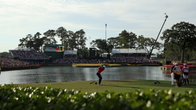 Jason Day plays a shot into the iconic 17th