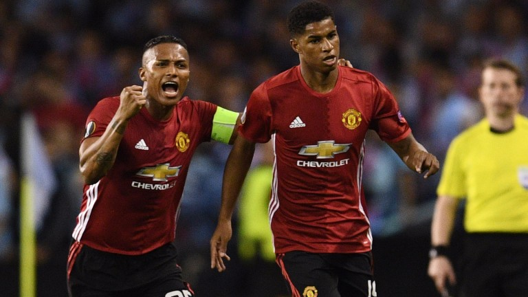 Marcus Rashford (right) and Antonio Valencia of Manchester United celebrate during the first leg