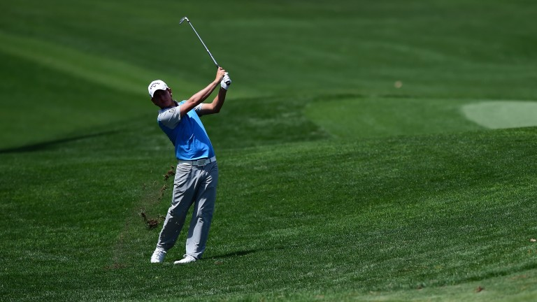 Emiliano Grillo plays an approach shot during round one of the Wells Fargo Championship