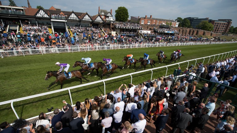 Early stages: runners in the Group 3 Chester Vase pass the stands for the first time