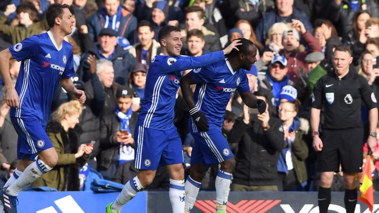 Eden Hazard celebrates after a stunning solo goal which helped to gain revenge on Arsenal