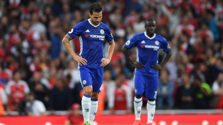 Cesc Fabregas looks dejected during a 3-0 defeat at Arsenal