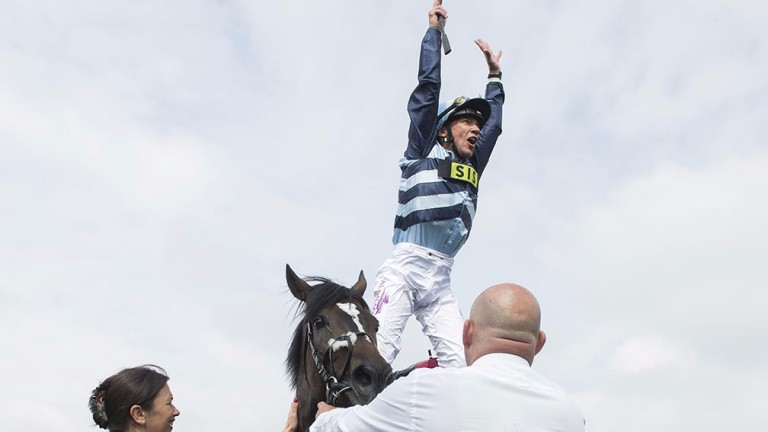 Frankie Dettori performs a flying dismount following Western Hymn win in the Ormonde Stakes