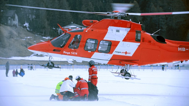 Medics prepare George Baker for airlifting from the frozen lake at St Moritz following his fall from Boomerang Bob