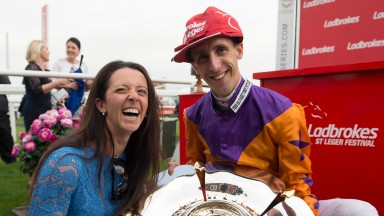 Laura Mongan and George Baker after winning the St Leger with Harbour Law Doncaster 10.9.16 Pic: Edward Whitaker