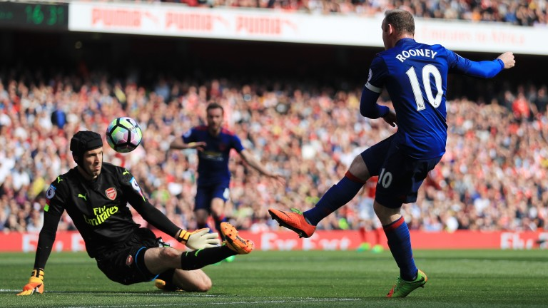 Wayne Rooney has a pop at goal against Arsenal