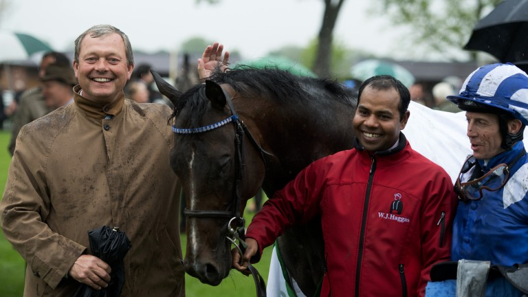 All smiles: William Haggas (left) and Jim Crowley (right) pose for a photo with Tasleet after their big-race success
