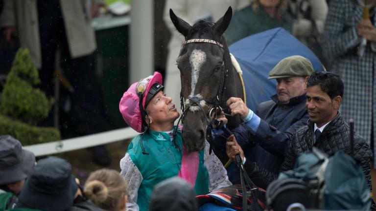Frankie Dettori looks up admiringly at Musidora Stakes winner Shutter Speed