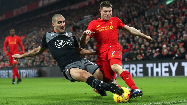 Oriol Romeu of Southampton makes a challenge on James Milner of Liverpool