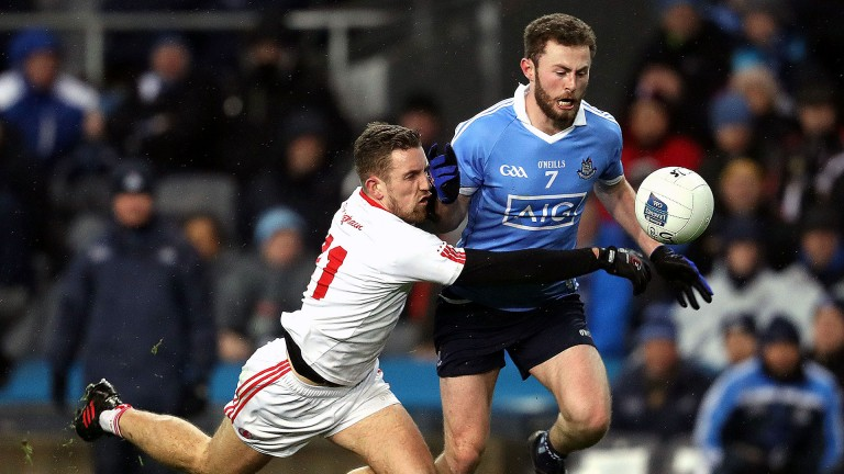 Tyrone's Niall Sludden challenges Jack McCaffrey of Dublin