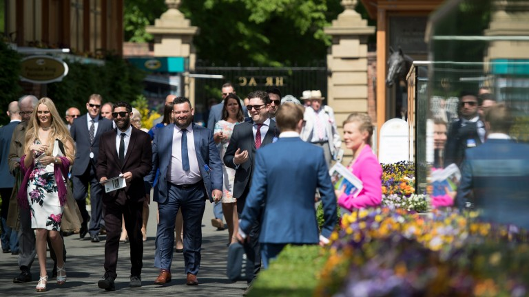 Smiling racegoers arrive for Dante day