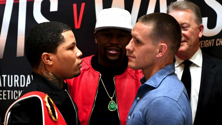 Gervonta Davis (left) and Liam Walsh square up as Floyd Mayweather looks on