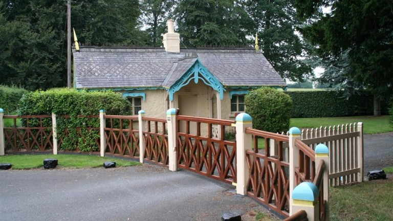 The gateposts and lodge are painted to match the discreet racing livery