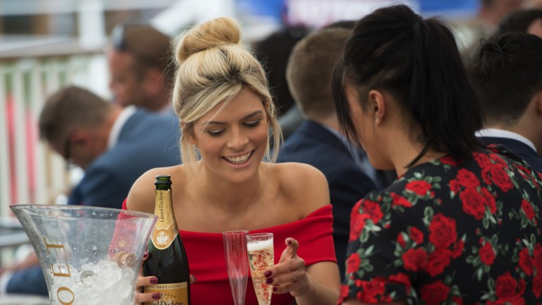 On ice: racegoers enjoy a bottle of champagne before racing