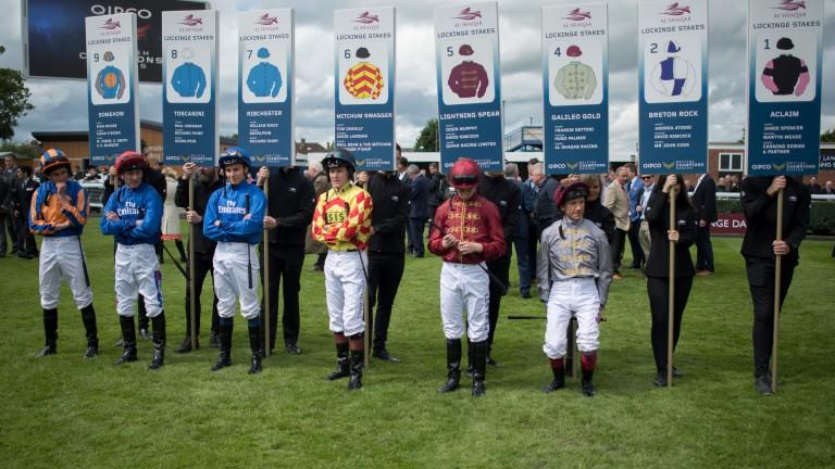 The jockeys line up before the Lockinge, with winning rider William Buick third left