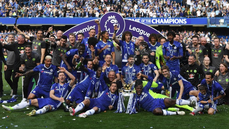 Chelsea celebrate with the Premier League trophy