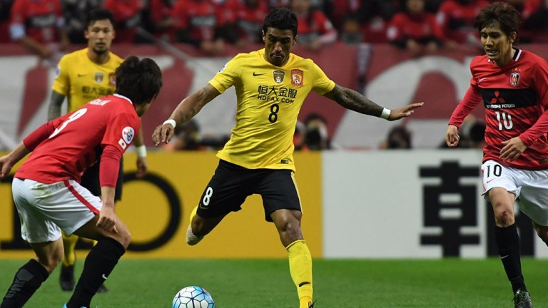 Guangzhou Evergrande's Paulinho (centre) in AFC Champions League action against Urawa Red Diamonds