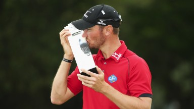 Chris Wood kisses the BMW PGA Championship trophy following last year's triumph at Wentworth