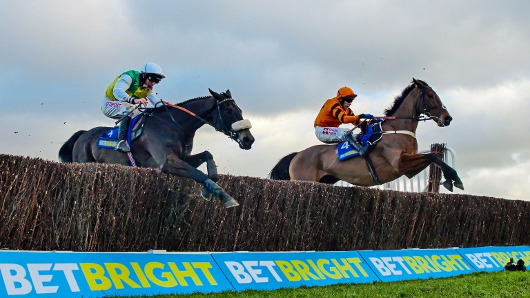 Many Clouds (left) en route to beating Thistlecrack in the Cotswold Chase at Cheltenham