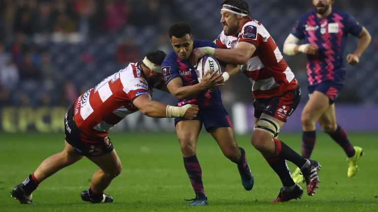 Will Genia of Stade Francais is tackled by Josh Hohneck (L) and Jeremy Thrush (R) of Gloucester