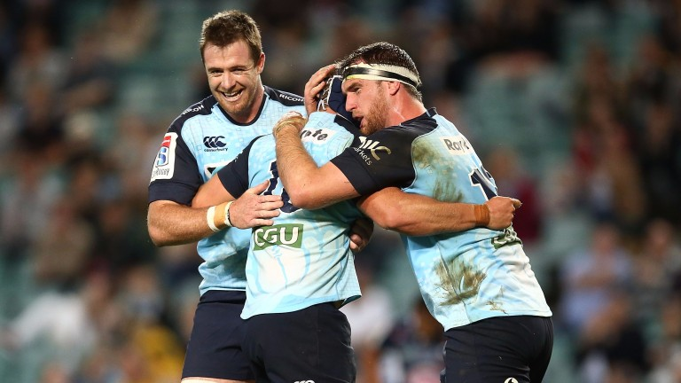 Damien Fitzpatrick of the Waratahs celebrates after scoring a try
