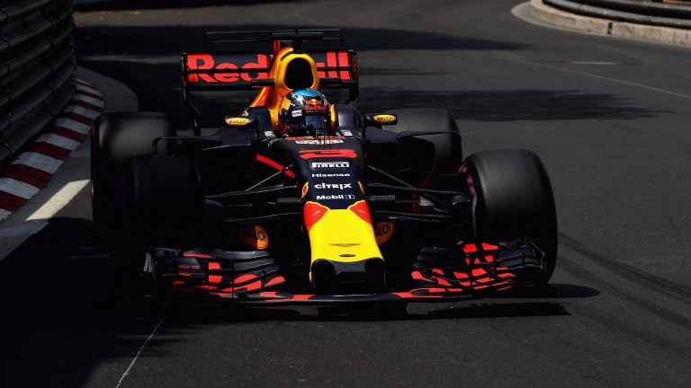 Daniel Ricciardo guides his Red Bull between the barriers during practice in Monaco