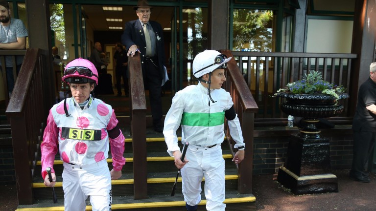 Jim Crowley (left) and William Buick wearing black armbands at Haydock