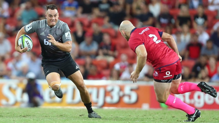 Israel Dagg of Crusaders takes on the Reds' defence