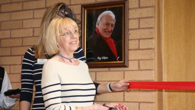 Sue Gilpin cuts the ribbon to open the press room named in honour of her late husband Ray