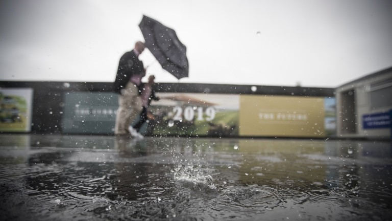 Racegoers fighting weather conditions.The Curragh.Photo: Patrick McCann 24.05.2017