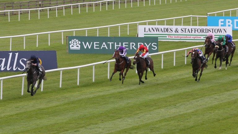 Curragh Sun 28 May 2017 Picture: Caroline Norris   Winter ridden by Ryan Moore running out the easy winner of The Tattersalls irish 1,000 Guineas from Roly Poly ridden by Seamus Heffernan, striped cap, 2nd, Hydrangea ridden by Padraig Beggy, 3rd, on rail