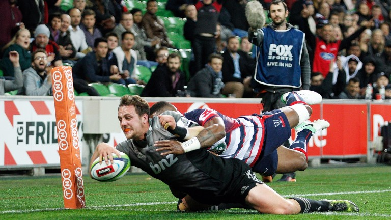 Jed Brown dives over for a Crusaders try against the Rebels