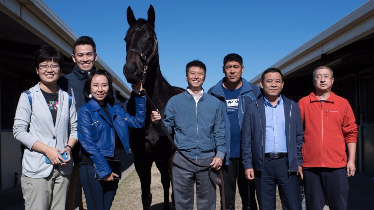 Zhang Yuesheng (centre) with the YuLong Investments team and their new purchase Gregers