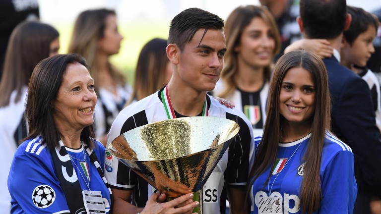 Paulo Dybala celebrates Juve being crowned Serie A champions