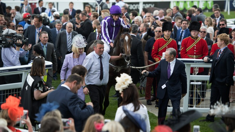 Reel rules: Highland Reel and Ryan Moore return to the winner's enclosure in front of the stands
