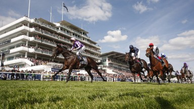 Wings Of Eagles (left) denies Cliffs Of Moher (centre) and Cracksman in the Derby