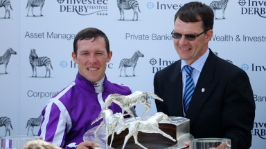 Padraig Beggy (left) with the Investec Derby trophy alongside winning trainer Aidan O'Brien
