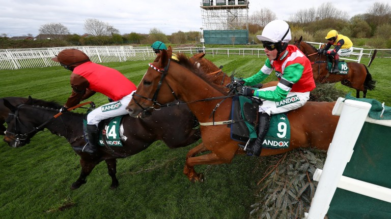 Dineur and James King jump the Canal Turn on the way to victory in the Foxhunters'