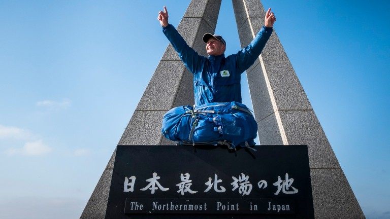 Richard Dunwoody celebrates his arrival at Cape Soya after 101 days on the road for cancer charity Sarcoma UK