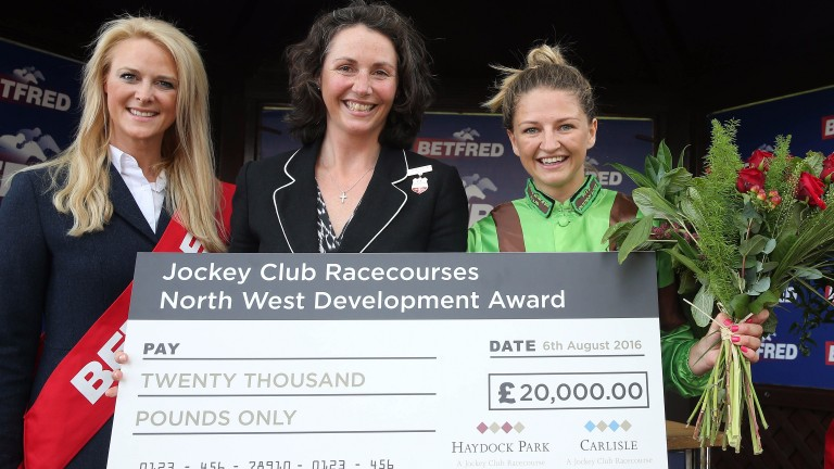 Emma Sayer receives her cheque as winner of the JCR development award for female riders