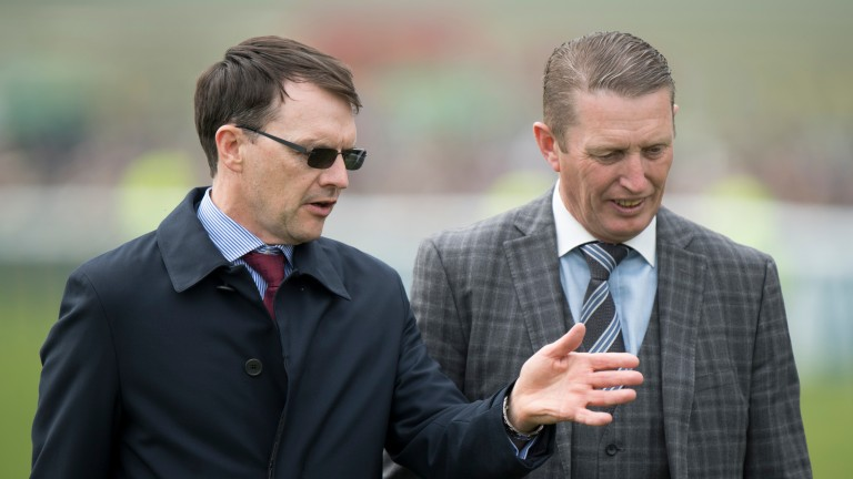 Aidan O'Brien, long renowned for thanking every member of his team after a victory, consults his travelling head lad Pat Keating