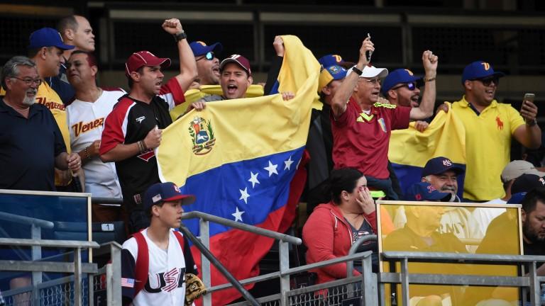 Venezuela fans cheer their team
