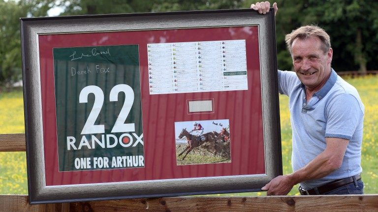 Steve Charlton with the framed saddlecloth and racecard that is open to bids on eBay