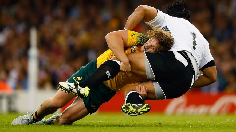Michael Hooper of Australia tackles Campese Ma'afu of Fiji during the 2015 Rugby World Cup
