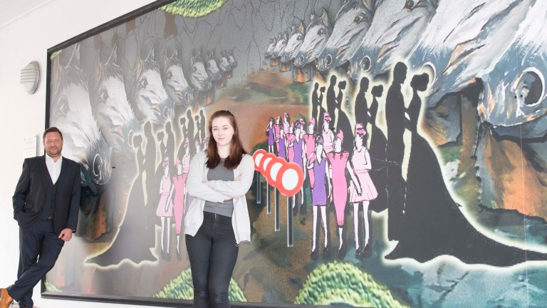 Hollie Jamieson with her winning mural design at Hamilton