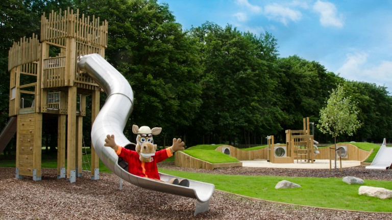 Rowley the mascot tests out the slide at the July course