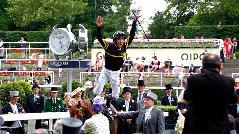 Frankie Dettori executes his famous flying dismount after victory on Undrafted