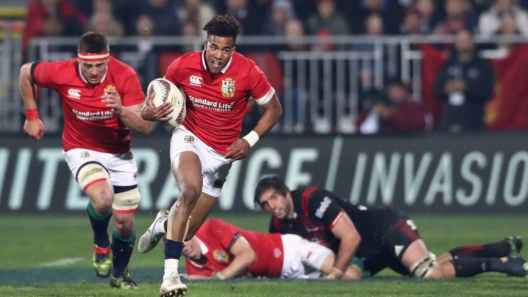 Anthony Watson makes a break for the Lions in their win over the Crusaders