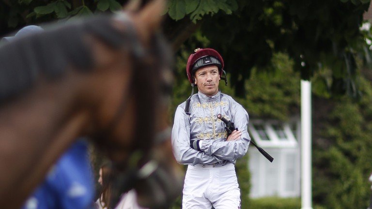 Alone with his thoughts: Frankie Dettori in the Al Shaqab silks at Sandown on Thursday