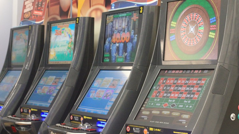 Defendants charged with wrecking betting shop machines: